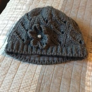 Gray winter knit hat with flower